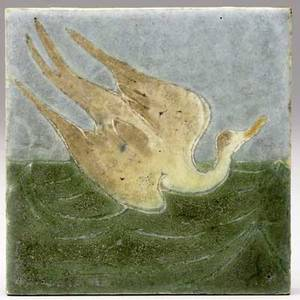 Grueby tile decorated in cuenca with a bird swooping down on green waves artists initials 4 sq