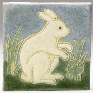 Grueby tile decorated in cuenca with an ivory rabbit in cabbage field artists initials 4 sq