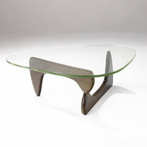 Isamu noguchi  herman miller coffee table with shaped pale yellowgreen glass top over twopiece wooden base an early first generation version of this table 15 34 x 50 x 36