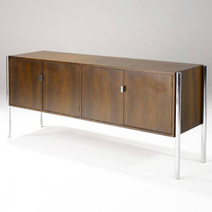 Directional credenza in walnut veneer with four doors enclosing divided drawer and single shelf on chrome legs 32 14 x 72 x 19