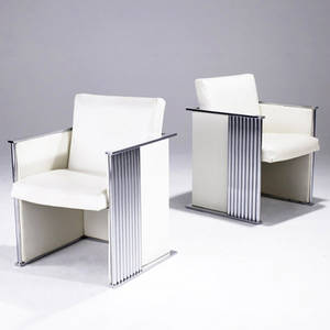 Milo baughman attr pair of chromed steel armchairs upholstered in white vinyl 31 x 23 14 x 21 12