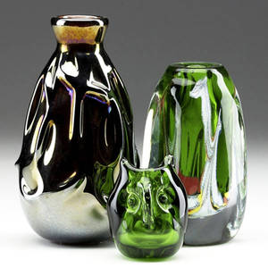 Dominick labino three glass pieces 197374 draped ovoid vase with iridescent bronzed finish foursided vase with multicolored internal decoration and small owl figurine in green all signed and d