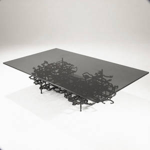 Style of ibram lassaw cocktail table with smoked plate glass top over sculptural steel base in dark patinated finish 16 x 60 x 36