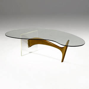 Style of vladimir kagan coffee table with biomorphic glass top over sculpted walnut and lucite base 16 34 x 65 x 36