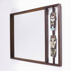 California craft wallhanging mirror in wood frame with figural glazed ceramic decorations 25 x 32