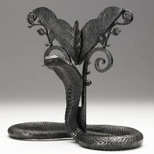Style of edgar brandt art deco patinated metal stand with python base with grooved backing for mirror or artwork provenance collection of juan montoya 11 34 x 13 x 6