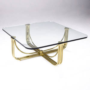 Mastercraft coffee table with plate glass top over solid brass base 16 14 x 40 sq