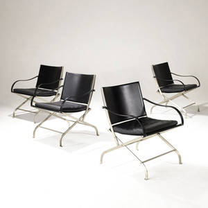 Italian set of four lounge chairs with black leather seats and covered armrests on folding steel frames 30 x 23 x 23