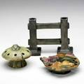 Weller three muskota pieces two flower frogs and one gate double bud vase restoration to both flower frogs unmarked