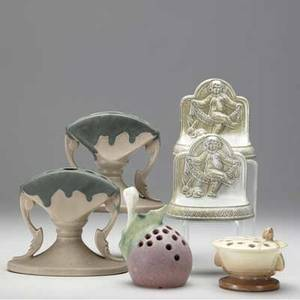 Roseville etc four flower frogs pair of carnelian i thornapple and teasel together with a pair of aetco bookends with cherubs