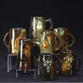 Weller seven mugs four louwelsa two floretta and one mccoy one painted by hester pillsbury restored around rim and one by madge hurst hairline to each floretta chip to one all marked but mccoy