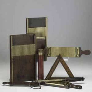 English implements seven brass and wood items include three pill rollers two cribbage boards salmon gaff and telescope all 19th c largest 8 x 14 x 2 12