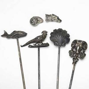 Figural silver miniatures grouping of six includes four french skewers in the form of a clam shell fish rams head and bird together with two boxes in the form of a nautilus shell and a dog all 19