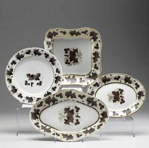 Worcester ten pieces of grapedecorated pieces include two rectangular serving dishes four oval platters and four plates all ca 17901810 largest 11 x 7 12