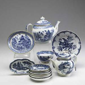 English porcelain twelve blue and white caughley and spode pieces include two teapots strainer and various bowls and underplates early 19th c largest 7 x 9