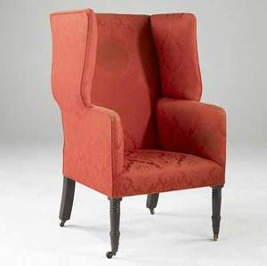 English wing chair upholstered in red silk on casters 19th c 26 x 27 x 52