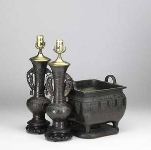 Japanese bronze three items a pair of urns converted to lamps together with a handled jardiniere on wooden base 19th20th c tallest 18 12