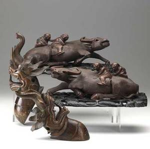 Asian carvings pair of figures depicting men and oxen together with pair of wall mounted dragons 19th c