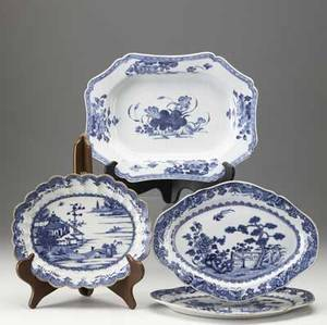 Chinese export grouping of four blue and white pieces includes pair of oval platters scalloped bowl and rectangular platter with restoration largest 10 12 x 14 12