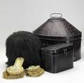 English militaria queens guard bear skin helmet together with naval epaulets and pith helmet in tole boxes largest 17 x 13 x 16
