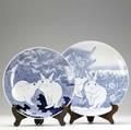 Japanese imari two rabbit decorated chargers one in a field of flowers one in a landscape with storks largest 16 dia