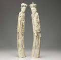 Chinese ivory tall figures of an emperor and empress the former with carved dragon decoration the latter with carved phoenix 20th c attractive patination to back on both minor loss to hair ornam