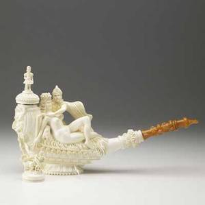 Meerschaum pipe elaborately carved by ismail ozel from a single piece of meershaum with the embracing figures of anthony and cleopatra the front panel depicting the god pan topped by a soldier with