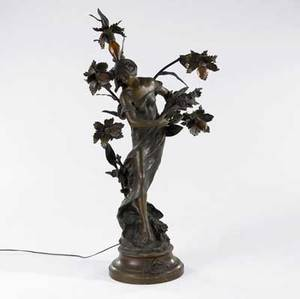 Auguste moreau french 18341917 art nouveau newel post figural lamp of a young woman with flowers in white metal early 20th c signed auguste moreau some losses to hair 47 x 25