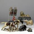 Carved wood huntsman and hounds pieces inlcude french legionnaire figures in polychrome composition and twelve ceramic and carved wood animal figures of sheep cattle dogs lions etc some with loss