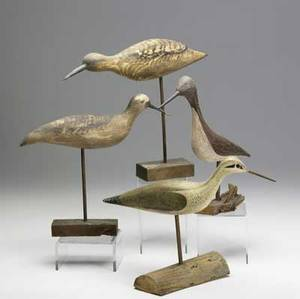 Shore bird decoys and carvings twelve items including four metal shore bird decoys fair condition and eight complete carvings of various shore bird on mounts intact condition with no paint loss t