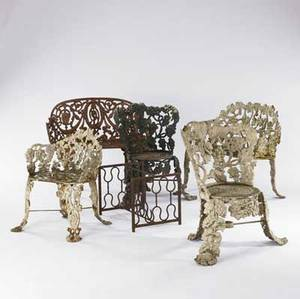 Garden furniture six wrought iron pieces with foliate designs include two settees three chairs and a table 20th c largest 29 12 x 36 12 x 17