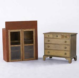 Country bracket foot chest three over three drawer configuration in painted pine together with a two door hanging cabinet in red paint all 19th c largest 31 x 38 12 x 13