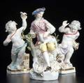Continental porcelain group of figurines young man and lamb by a tree 19th c losses early meissen mark crossed sword and dot pair of putti one holding a bird several restorations other with