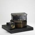 Oriental lacquer four pieces include tea caddy two boxes and a toleware document box 19th c largest 19 x 19
