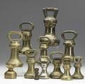 English brass weights grouping of twelve mostly bellshaped with various makers and sizes largest 8