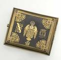 Damascene cigarette case fine example made for spanish nobility arched steel case the front a moorish rondelle of tricolor inlay with brackets of palmette interlacing the reverse with the coat of