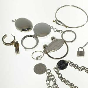 Tiffany  co ten pieces of silver jewelry and accessories 19952002 some discontinued large oval locket magnifying glass key chain hook and eye bracelet with 18k yg 1837 lock pendant and chain