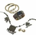 Ethnic  ivory jewelry five pieces 19301980 pair of hinged ivory cuffs dyed ivory and lapis cuff silver necklace depicting hindu gods ivory and 14k ear clips