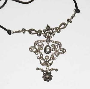 Rose cut diamond necklace late georgian or victorian silver and silvertopped gold in the rococo style foilbacked and open set diamonds of various shapes milligrain details later satin cord 3