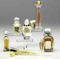 Nine givenchy perfumes include three le de givenchy 1979 miniature containing linterdit 1980 5 oz ysatis 1987 one organza 2000 three damarig 2000 two with flameshaped stopp