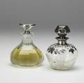 Two gorham silverfitted perfumes one with etched floral decoration silver cased shoulder and stopper the other faceted with monogrammed silver stopper both ca 1910 faceted marked gorham sterling