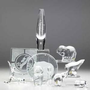 Art glass elevenpiece group lot of crystal figurines plaques and table items some with etched decoration including a robert browning vase by steuben an owl figurine by kosta elephant and polar