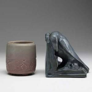 Rookwood two production items single rook bookend in dark blue glaze 1924 restored and footed vase with grape vines 1914 chip to foot and bruise to rim both marked bookend 7 x 6 vase 5