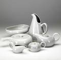 Russel wright american modern dinnerware grouping includes pitcher teapot creamer  sugar covered serving dish and oval serving dish all in gray glaze chip to teapot all marked russell wrigh