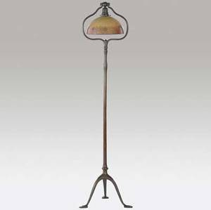 tiffany studios  handel bronze tripod floor lamp with harp fitted with a handel hemispherical shade reversepainted with a floral band and topped with a bronze collar fine original patina to base