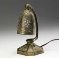 Tiffany studios giltbronze abalone desk lamp with adjustable shade lined in caramel slag glass some wear to finish tiffany studios new york 556 9