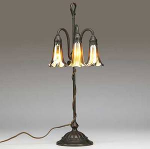 tiffany studios threelight lily table lamp with gold favrile shades on an adjustable floriform bronze base with verdigris patina from a local estate we believe this piece to be in mint original c