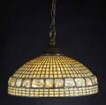 tiffany studios chandelier with a band of large turtleback tiles amidst leaded amber ripple glass complete with bronze vented cap and hook singlesocket fixture replaced chain and ceiling mount