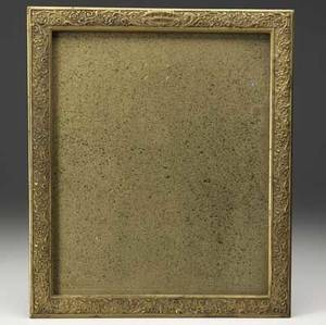 Tiffany studios giltbronze picture frame in a renaissance floral motif topped by two dolphins stamped tiffany studios new york 1611 picture 8 14 x 10 12 frame 11 34 x 9 34