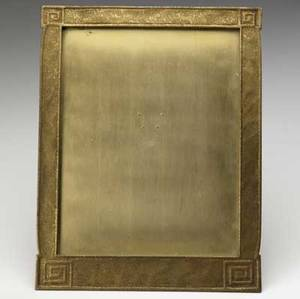Tiffany studios giltbronze picture frame in the modeled pattern stamped tiffany studios new york 1128 11 14 x 8 34